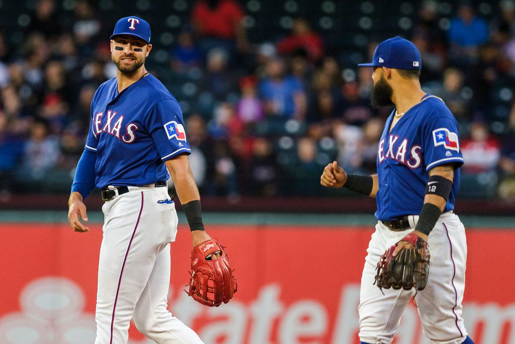 Texas Rangers outfielder Joey Gallo laughs with second baseman Rougned Odor during the second inning against the Houston Astros at Globe Life Park on Wednesday, April 3, 2019, in Arlington. (Smiley N. Pool/The Dallas Morning News)