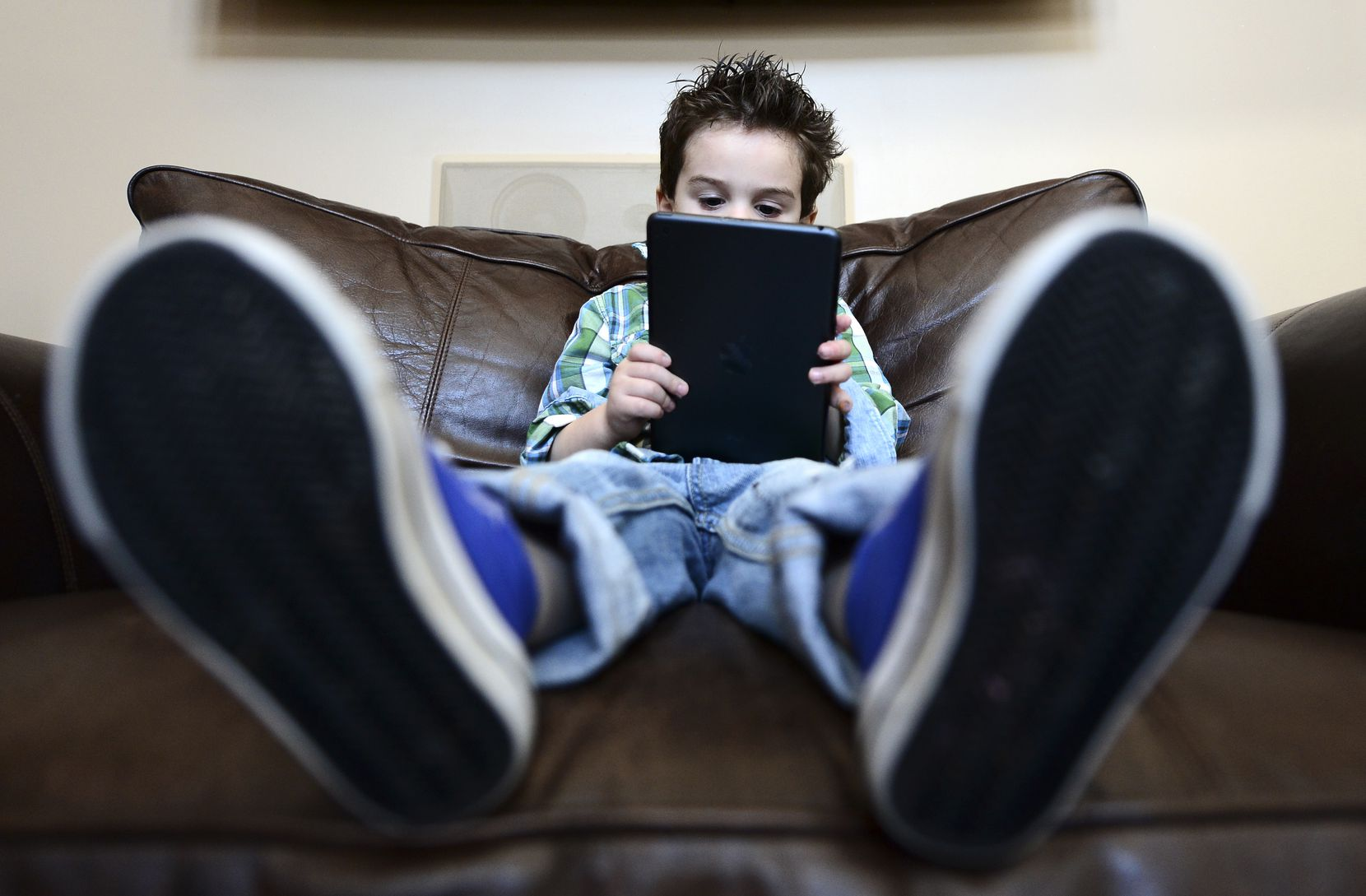 Limiting screen time is one way author Katherine Reynolds Lewis suggests parents can increase family bonding and reduce bad behavior.
