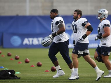 Cowboys offensive tackle Tyron Smith (77) and guards Zack Martin (70) and Connor Williams (52) make their way to the field for practice during training camp at The Star in Frisco on Sunday, Aug. 16, 2020.