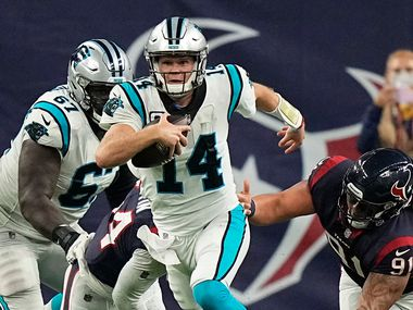 Carolina Panthers quarterback Sam Darnold (14) breaks away from Houston Texans defensive tackle Roy Lopez (91) during the second half of an NFL football game Thursday, Sept. 23, 2021, in Houston.