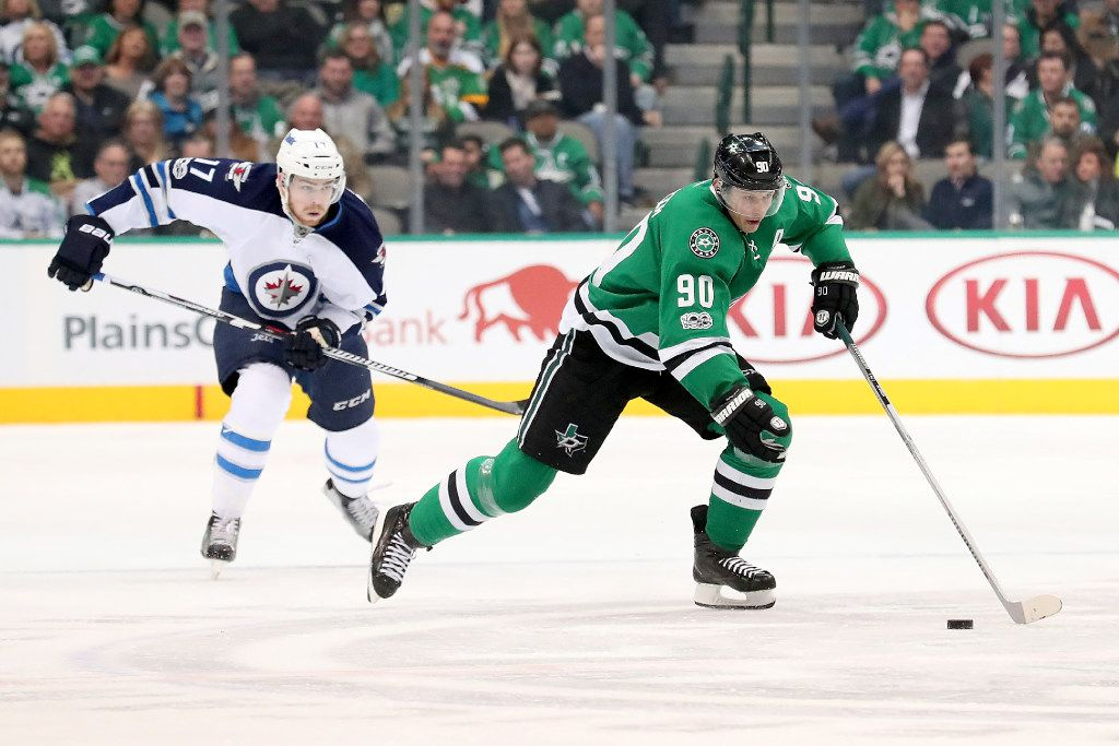 DALLAS, TX - FEBRUARY 02:  Jason Spezza #90 of the Dallas Stars controls the puck against Adam Lowry #17 of the Winnipeg Jets in the first period at American Airlines Center on February 2, 2017 in Dallas, Texas.  (Photo by Tom Pennington/Getty Images)