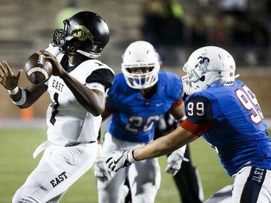 Plano East quarterback Brandon Mallory (1) gets off a 71-yard touchdown pass under pressure from Allen defensive lineman Brenden O'Brien (99) during the third quarter of a District 6-6A high school football game at Eagle Stadium on Friday, Nov. 3, 2017, in Allen, Texas.