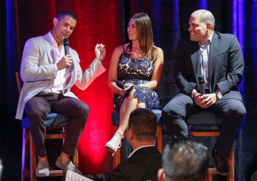 "Former Texas Rangers Michael Young, left,   recalls his first baseball encounter with Ivan ""Pudge"" Rodriguez, far right, as moderator Emily Jones, center, listens. They were one of two panel discussions at the Legends and Leaders event Tuesday August 22, 2017, held at Cholula Porch at Globe Life Park in Arlington. The event was sponsored by the Arlington Chamber of Commerce. (Ron Baselice/The Dallas Morning News)"