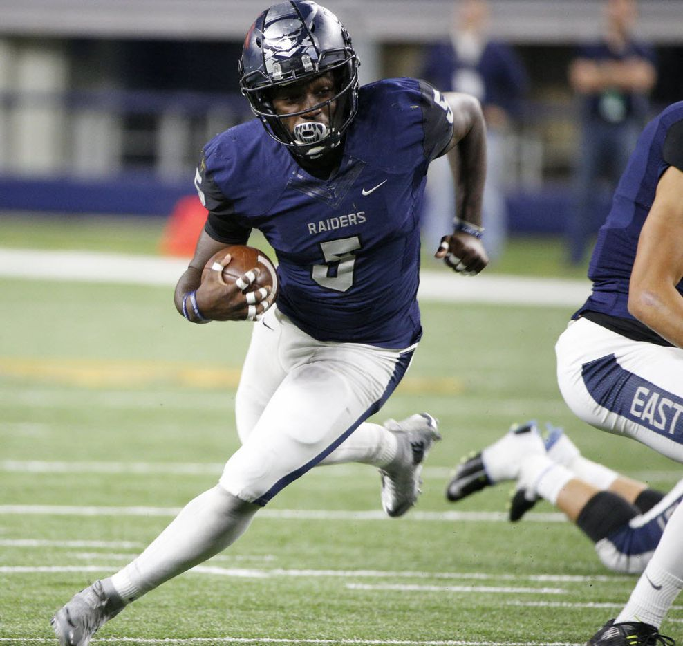 Wylie East's Eno Benjamin runs the ball against The Colony during their high school playoff football game at AT&T Stadium in Arlington, Texas November 13, 2015.   (Nathan Hunsinger The Dallas Morning News)