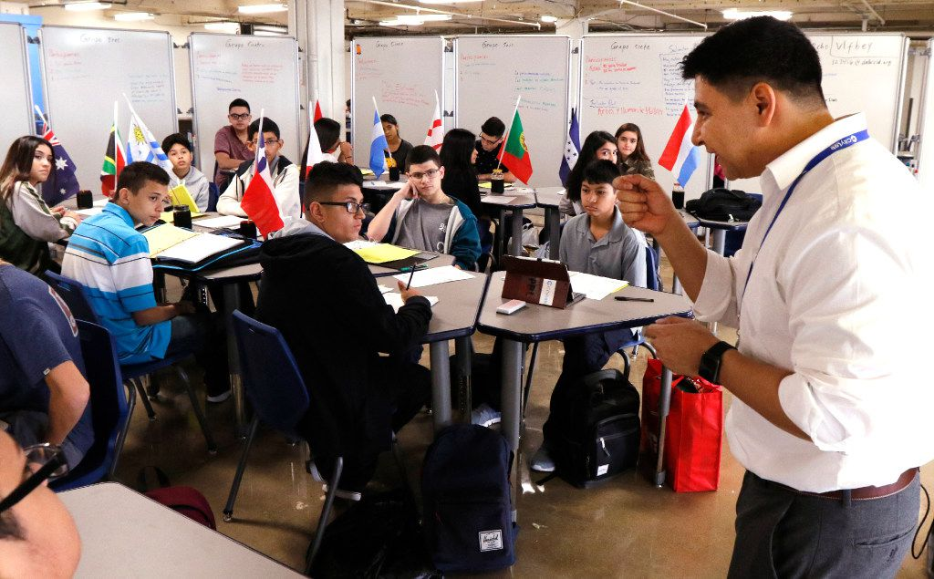 Daniel Mejia (right) teaches Spanish to ninth-graders at CityLab High School on the first day of school Monday in downtown Dallas. (David Woo/Staff Photographer)