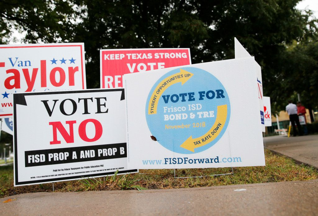 Signs for and against the Frisco ISD Bond & TRE outside a polling station at Collin College Preston Ridge Campus in Frisco on Oct. 25.