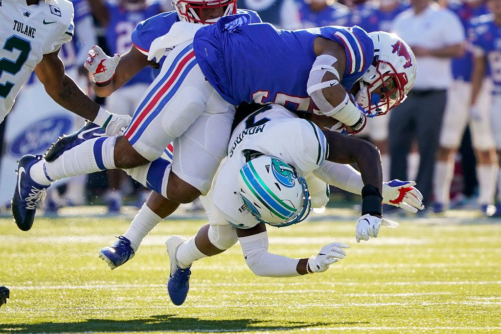 SMU running back Xavier Jones (5) is brought down by Tulane cornerback Jaylon Monroe (9) on a 38-yard run during the first half of an NCAA football game at Ford Stadium on Saturday, Nov. 30, 2019, in Dallas. (Smiley N. Pool/The Dallas Morning News)