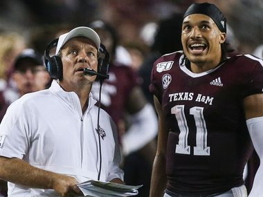 Texas A&M Aggies head coach Jimbo Fisher and quarterback Kellen Mond (11) watch as a play is reviewed during the fourth quarter of a college football game between Texas A&M and Texas State on Thursday, Aug. 29, 2019 at Kyle Field in College Station, Texas.