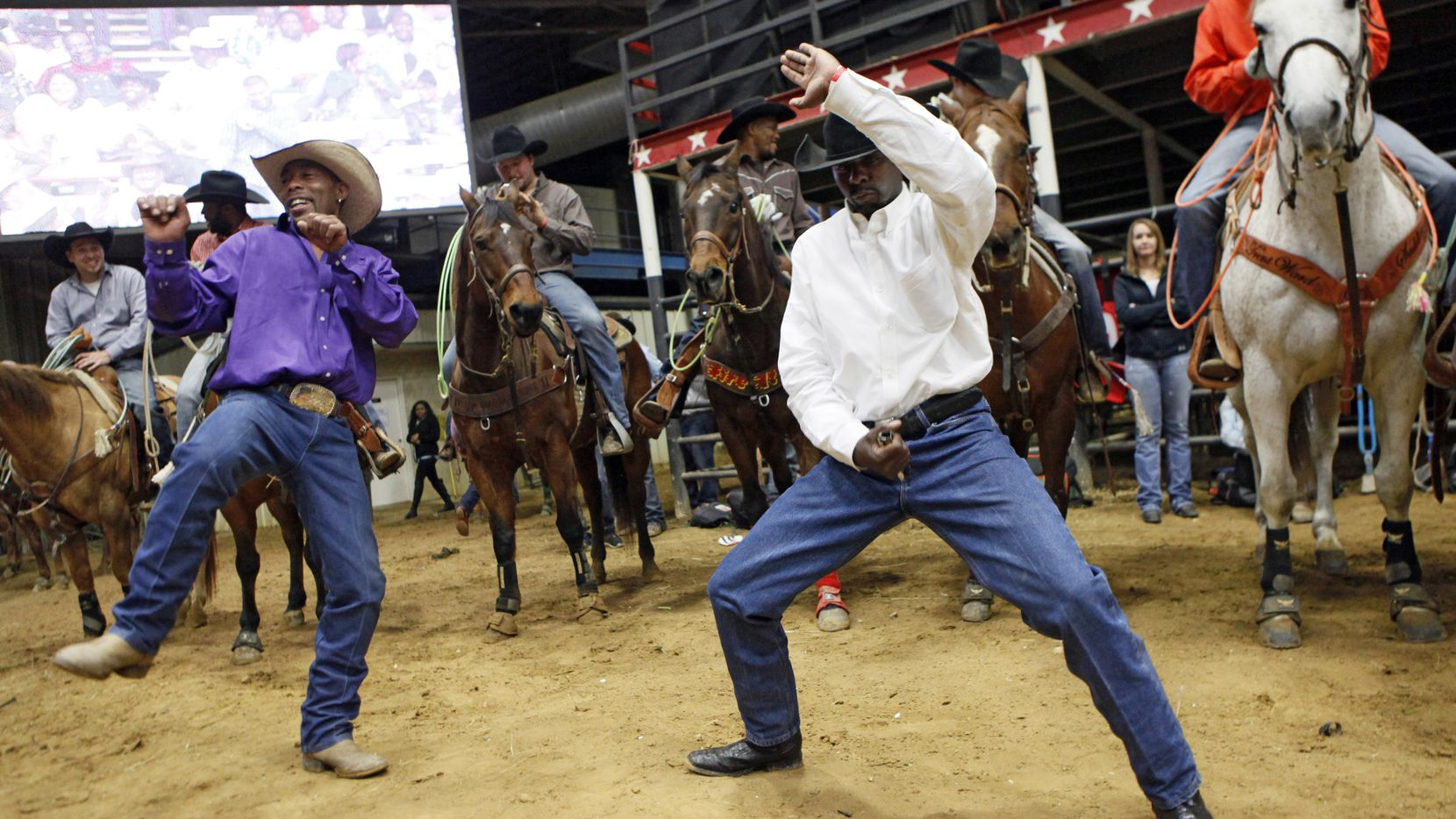 Cowboys Dennis Ezell, also known as Bronco, left, and Tyrone Williams show off their dancing skills as hip hop music is played through speakers at the Hip Hop Cowboys Spring Rodeo in Mesquite.
