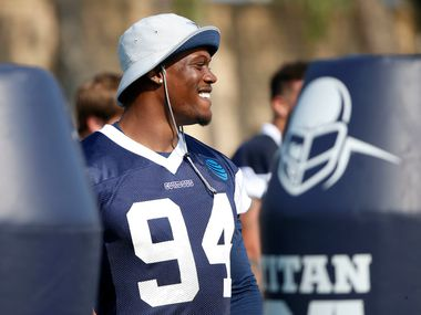 Dallas Cowboys defensive end Randy Gregory smiles during afternoon practice at the training camp in Oxnard, Calif., Friday, July 27, 2018.