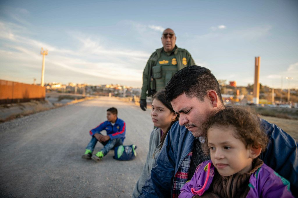 Jose Francisco Juárez and his daughters, 5-year-old Perla Victoria and 17-year-old Helen, who traveled from Honduras to ask for asylum in the United States. They were part of a group of Central American migrants that included a teenager, left, traveling alone from Honduras. All waited March 4 for the border patrol to transport them to a processing center in El Paso.