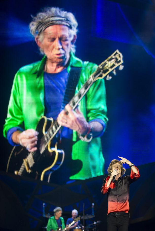 Mick Jagger of The Rolling Stones sings in front of larger than life image of Keith Richards as they perform at AT&T Stadium as part of their Zip Code Tour of North America on Saturday, June 6, 2015, in Arlington, Texas. (Smiley N. Pool/The Dallas Morning News)