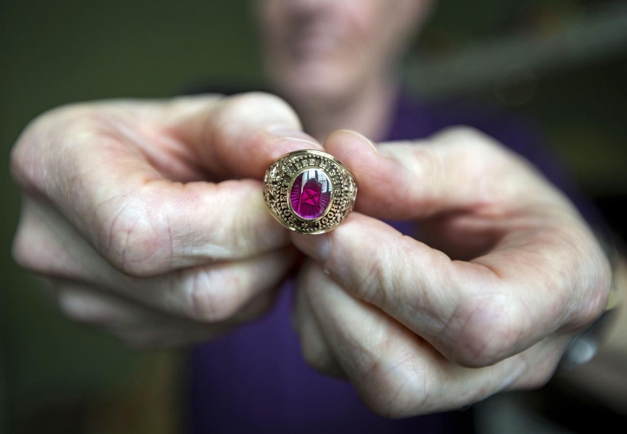 Terry Broxson's class ring from 1964 has a small Confederate battle flag under the stone. He is trying to figure out whether to openly cherish it or keep it tucked away in a closet.