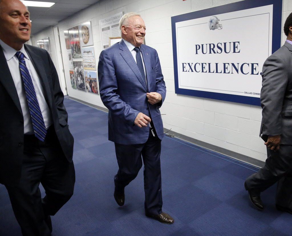 Dallas Cowboys owner Jerry Jones (center) arrives to a news conference about their first round pick, Ohio St. running back Ezekiel Elliott, at Valley Ranch, Thursday, April 28, 2016. (Tom Fox/The Dallas Morning News)