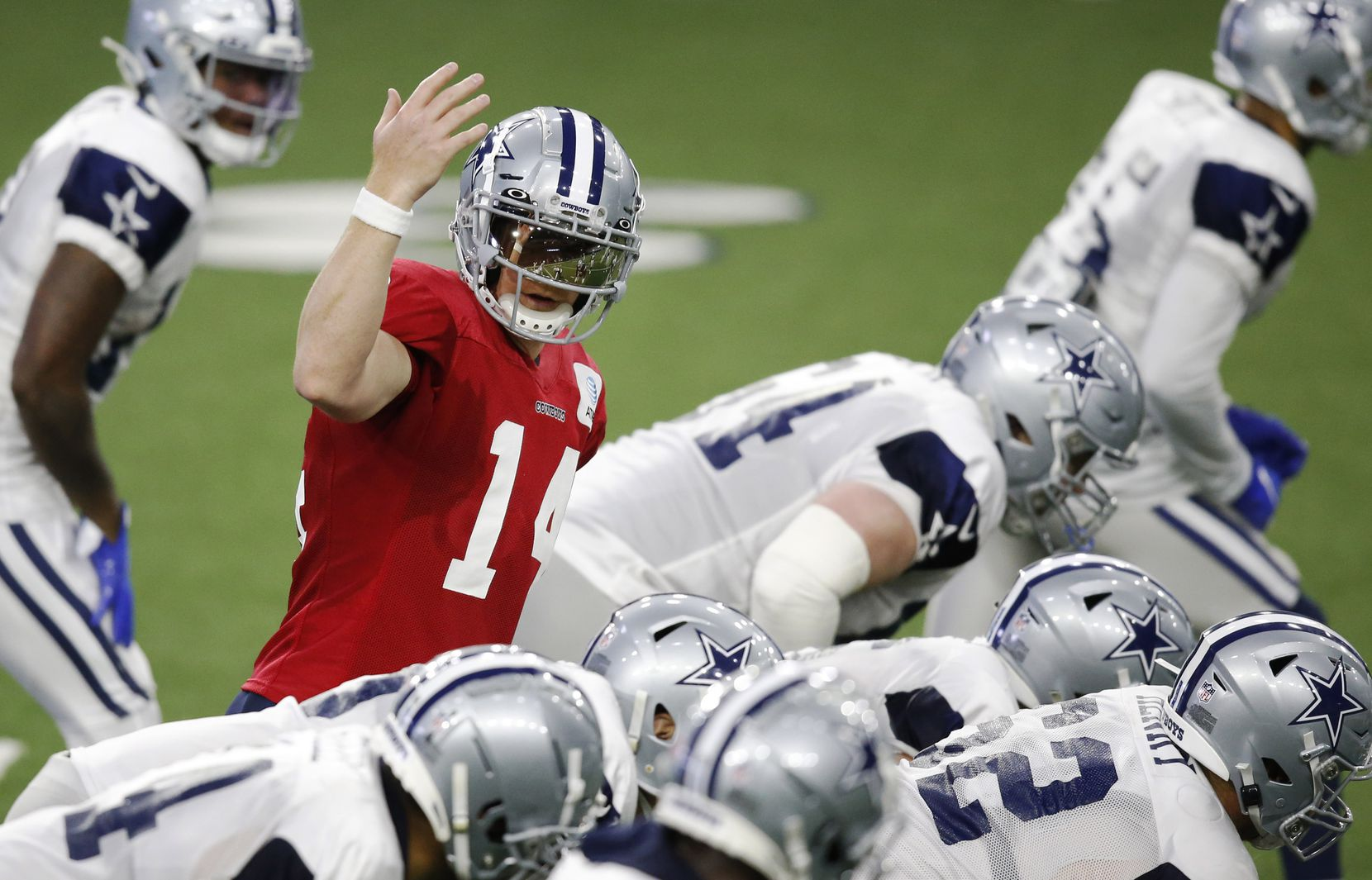 Dallas Cowboys quarterback Andy Dalton (14) signals to a teammate before the snap during training camp at the Dallas Cowboys headquarters at The Star in Frisco, Texas on Thursday, August 27, 2020. (Vernon Bryant/The Dallas Morning News)