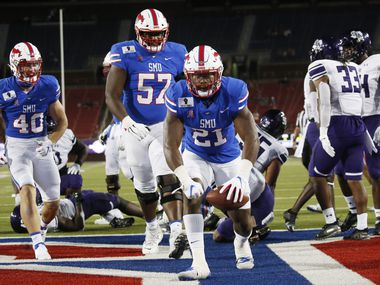 SMU running back TaMerik Williams (21) celebrates a touchdown against Stephen F. Austin during the second half of a game at Ford Stadium in Dallas on Saturday, Sept. 26, 2020.