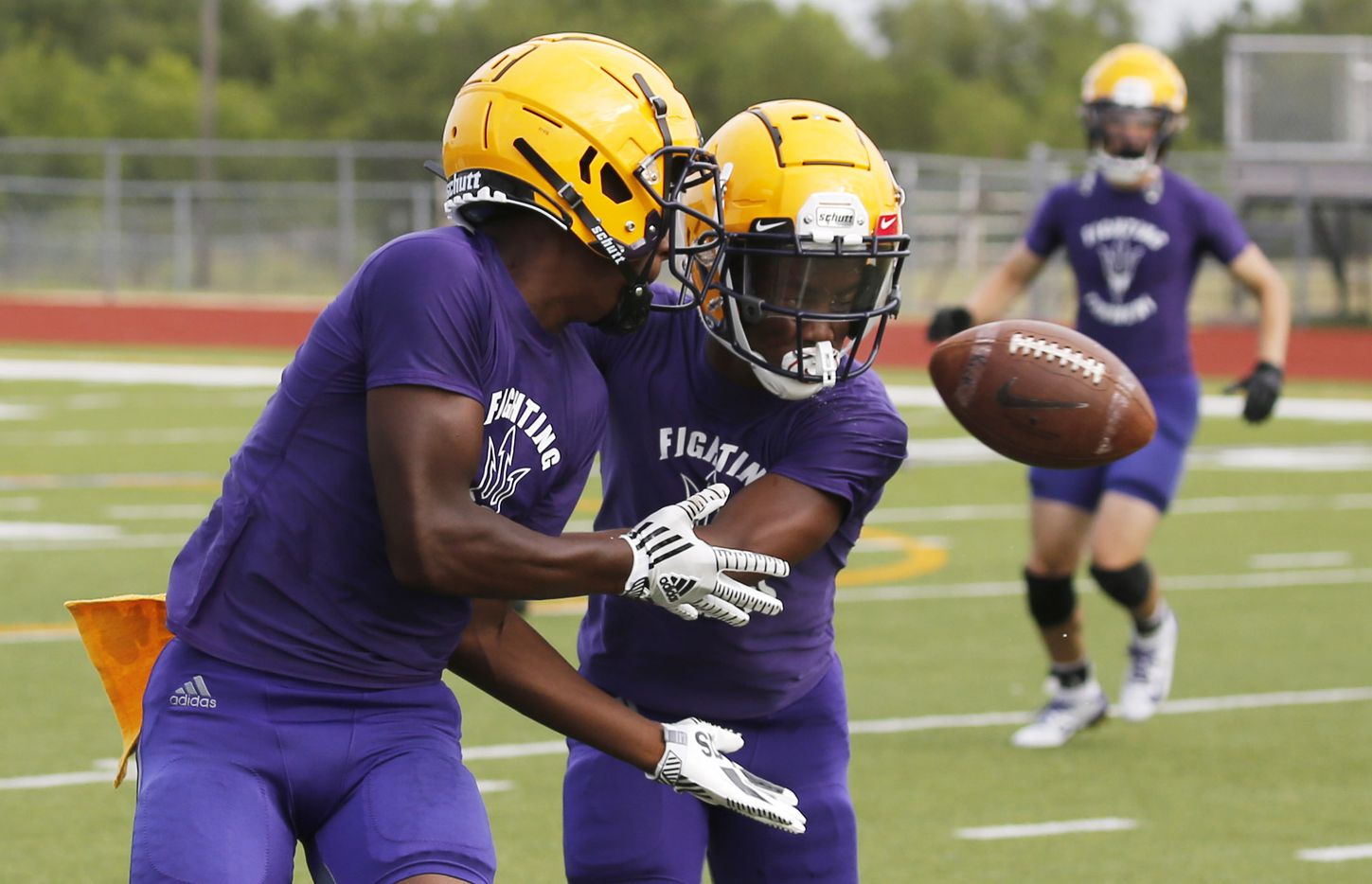 Farmersville's Jeralin Craddock (right) breaks up a pass intended for Farmersville's Noah Cottle (left) during the first day of high school football practice for 4A's Farmersville High School in Farmersville, Texas on Monday, August 3, 2020. (Vernon Bryant/The Dallas Morning News)