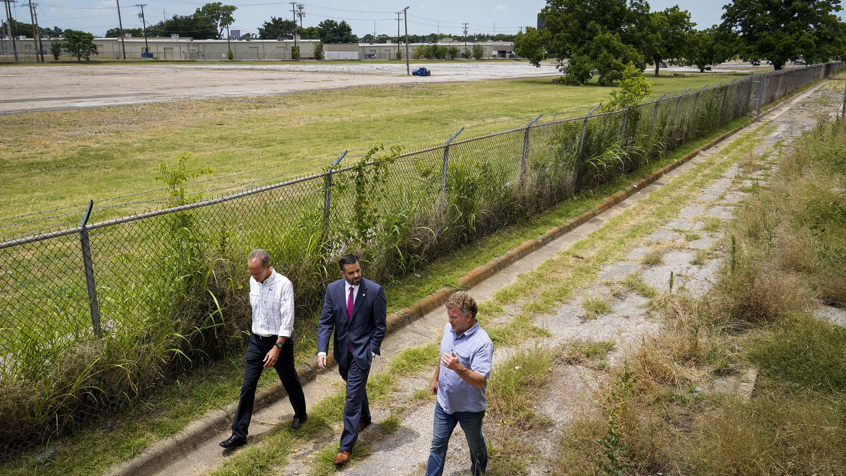 From left, City of Refuge Dallas CEO Mike Reinsel, Dallas City Council member Adam McGough and Bonton Farms founder Daron Babcock walk along the perimeter of a property at 12000 Greenville Avenue where they hope to create Bonton Village @ Lake Highlands.