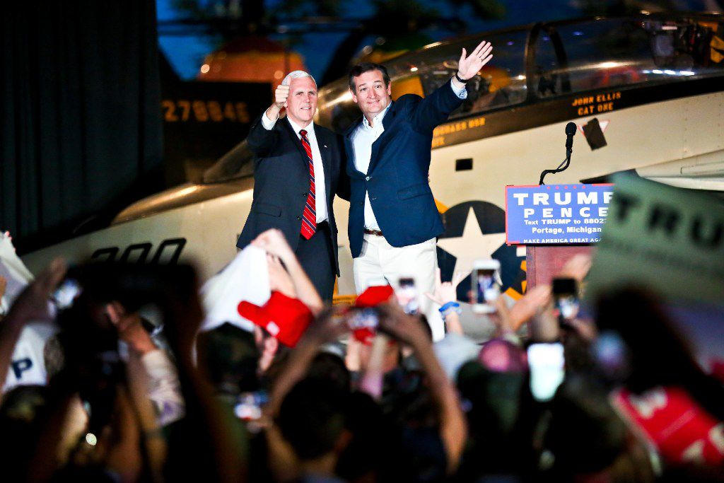 Vice President-elect Mike Pence and Sen. Ted Cruz greeted the crowd during a campaign stop at the Air Zoo on Thursday, Nov. 3, 2016 in Portage, Mich.  (Chelsea Purgahn/Kalamazoo Gazette-MLive Media Group via AP)