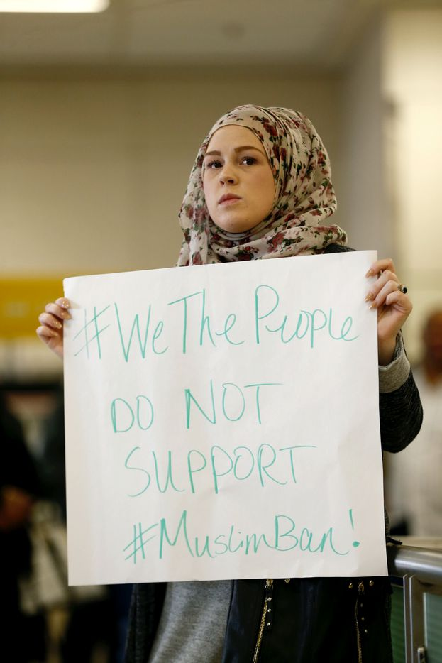 April Harrison-Bader protests President Donald Trump's executive action barring individuals from certain Muslim majority countries from entering the United States at Terminal D at Dallas Fort Worth Airport, Saturday, Jan. 28, 2017.