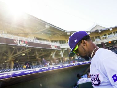 Texas Rangers outfielder Leody Taveras heads to the dugout during the eighth inning of a spring training game against the Kansas City Royals at Surprise Stadium on Tuesday, Feb. 25, 2020, in Surprise, Ariz.