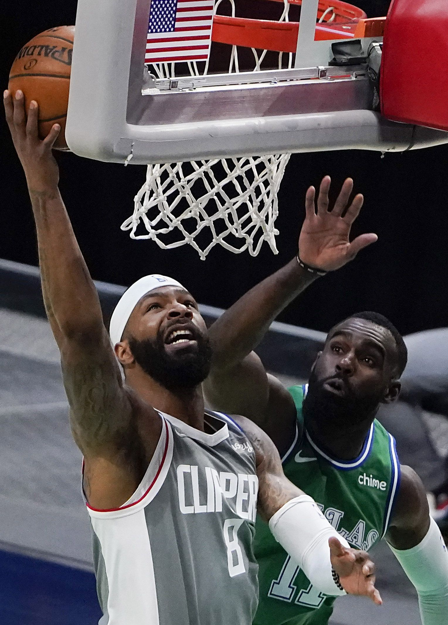 LA Clippers forward Marcus Morris Sr. (8) shoots past Dallas Mavericks forward Tim Hardaway Jr. (11) during the first quarter of an NBA basketball game at American Airlines Center on Wednesday, March 17, 2021, in Dallas.