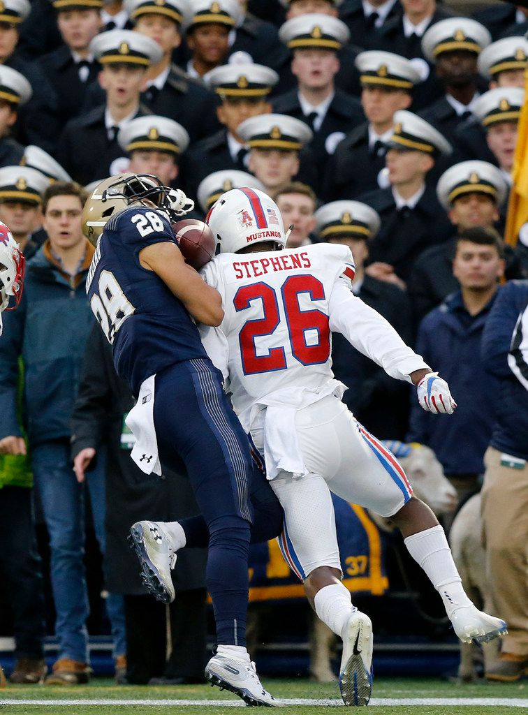 Southern Methodist Mustangs defensive back Brandon Stephens (26) puts a hard hit in Navy Midshipmen wide receiver Keoni-Kordell Makekau (28) as he tried to catch a pass on the three yard line during the first quarter at Navy-Marine Corps Memorial Stadium in Annapolis, Maryland, Saturday, November 23, 2019. Officials overturned a targeting call on Stephens. (Tom Fox/The Dallas Morning News)