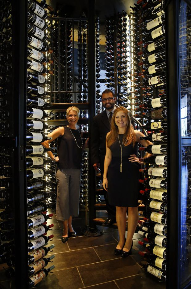 Sommeliers Jessica Davis (left) and Steven Orozco (center) and wine director Chantel Daves pose for a photo in the circular wine tower at the new Del Frisco's Double Eagle Steak House in Uptown Dallas, Friday, September 9, 2016. (Tom Fox/The Dallas Morning News)