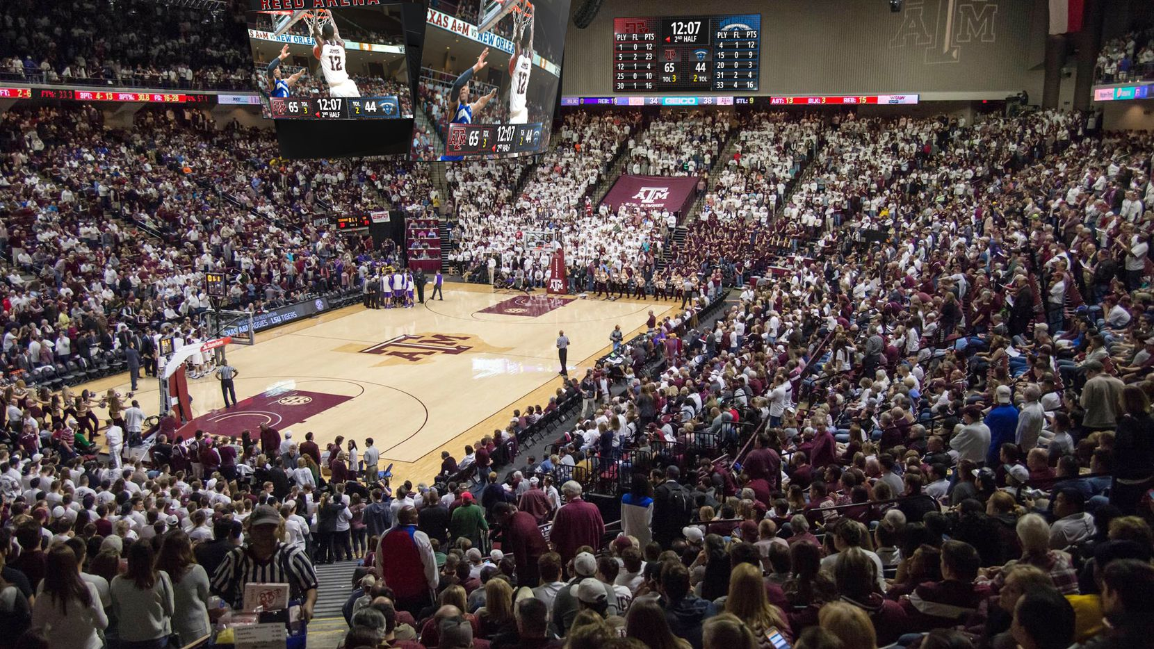 A new central-hanging scoreboard inside Reed Arena is part of a Texas A&M campus-wide upgrade package that costs more than $6.6 million.