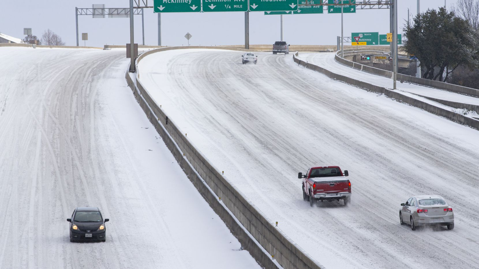 Snow covers Woodall Rodgers Freeway in Downtown Dallas on Monday, Feb. 15, 2021.
