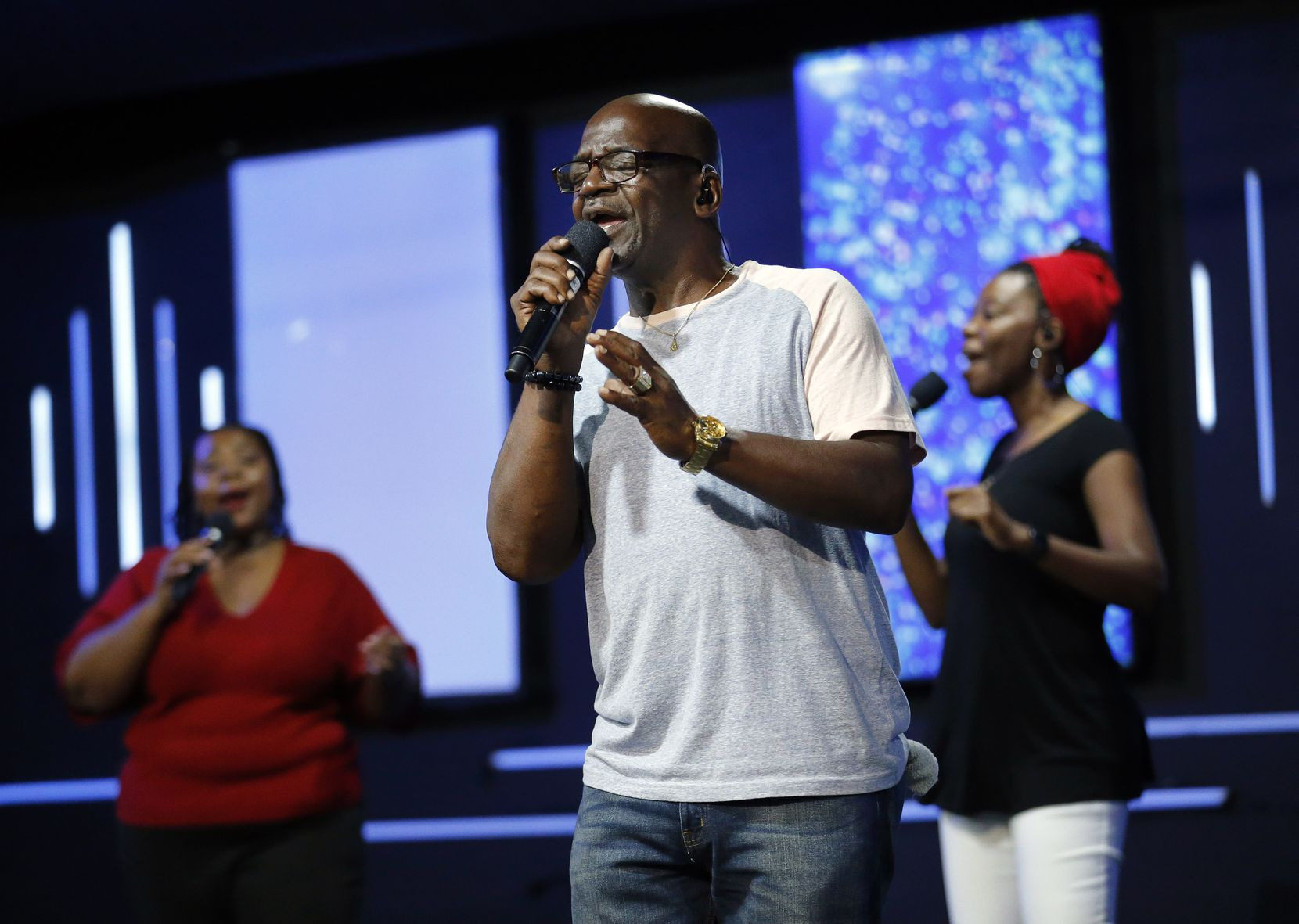 """Ivan Tucker leads the praise team in song with Candice Bryant (left) and Monisha Randolph during a Wednesday night rehearsal for Sunday's """"virtual"""" service."""