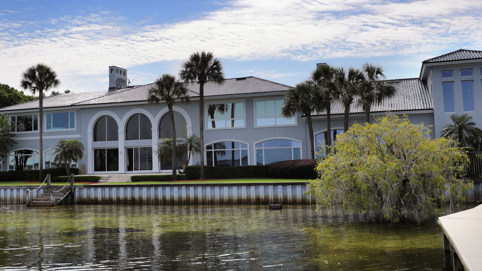A view from the backyard on Lake Butler of the 31,000-square-foot home currently owned by NBA legend Shaquille O'Neal, located at 9927 Giffin Court, in Windermere, Fla., photographed on April 14. The lakefront house is for sale for 6.5 million and includes 12 bedrooms, 11.5 bathrooms and its own movie theater, cigar bar and an indoor regulation basketball court.