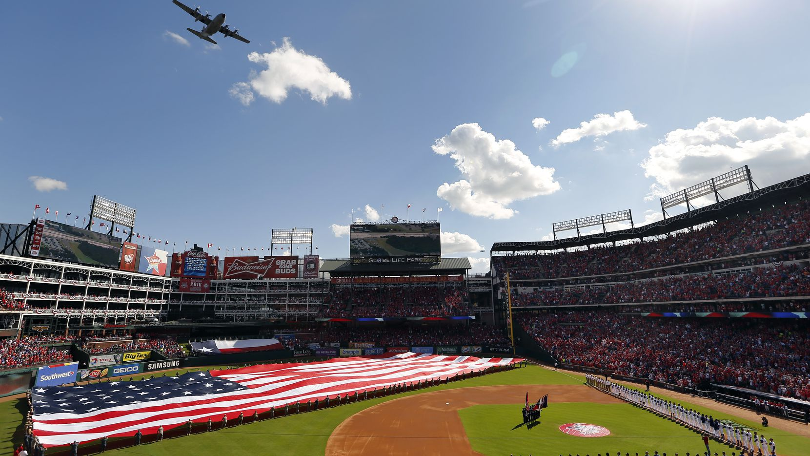 A C-130 from the 136th Airlift Wing Texas Air National Guard performs the flyover during the National Anthem before the ALDS Series Game 1 at Globe Life Park in Arlington, Thursday, October 6, 2016. (Tom Fox/The Dallas Morning News)