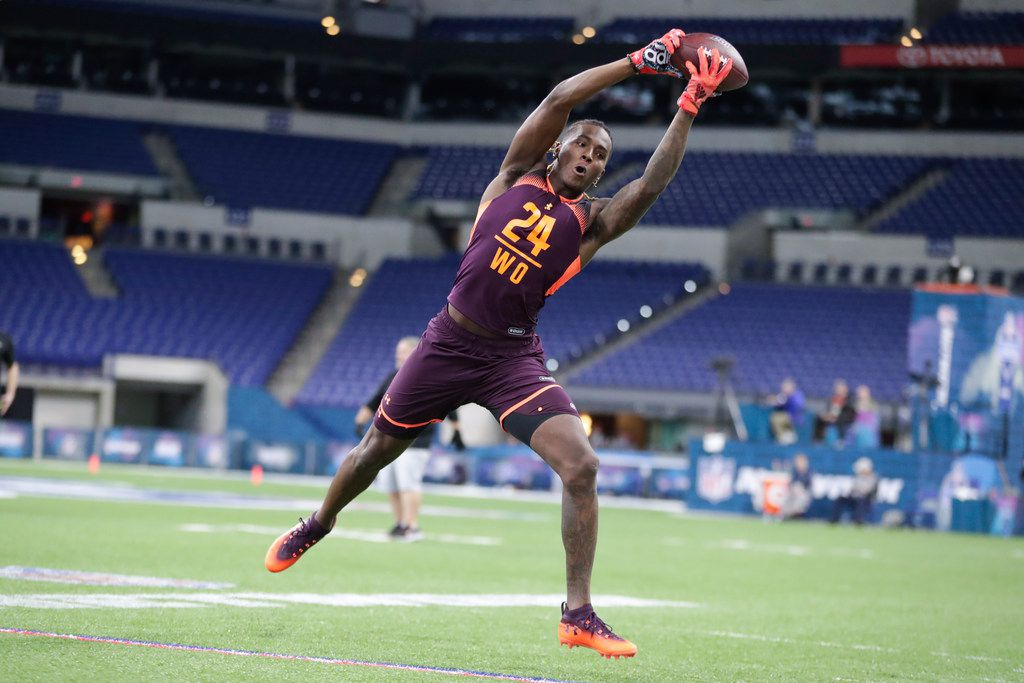 Texas wide receiver Lil'Jordan Humphrey runs a drill at the NFL football scouting combine in Indianapolis, Saturday, March 2, 2019. (AP Photo/Michael Conroy)