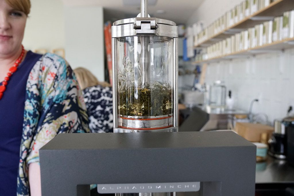 Tiffany Malkowski uses an Alpha Dominche Steampunk machine to brew tea.