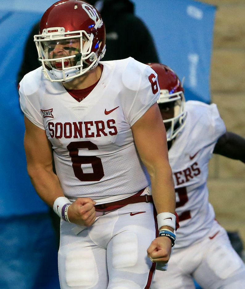 Oklahoma quarterback Baker Mayfield (6) celebrates a touchdown during the second half of an NCAA college football game against Kansas State in Manhattan, Kan., Saturday, Oct. 21, 2017. Oklahoma defeated Kansas State 42-35. (AP Photo/Orlin Wagner)