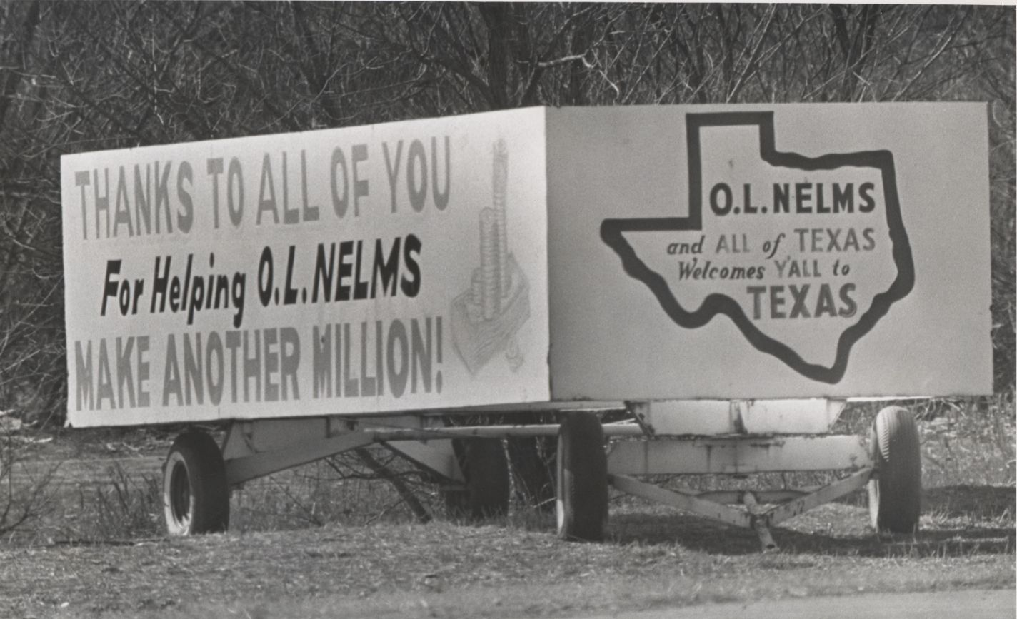 O.L. Nelms, a retailer and real estate developer, parked trailers all over Dallas emblazoned with his motto.