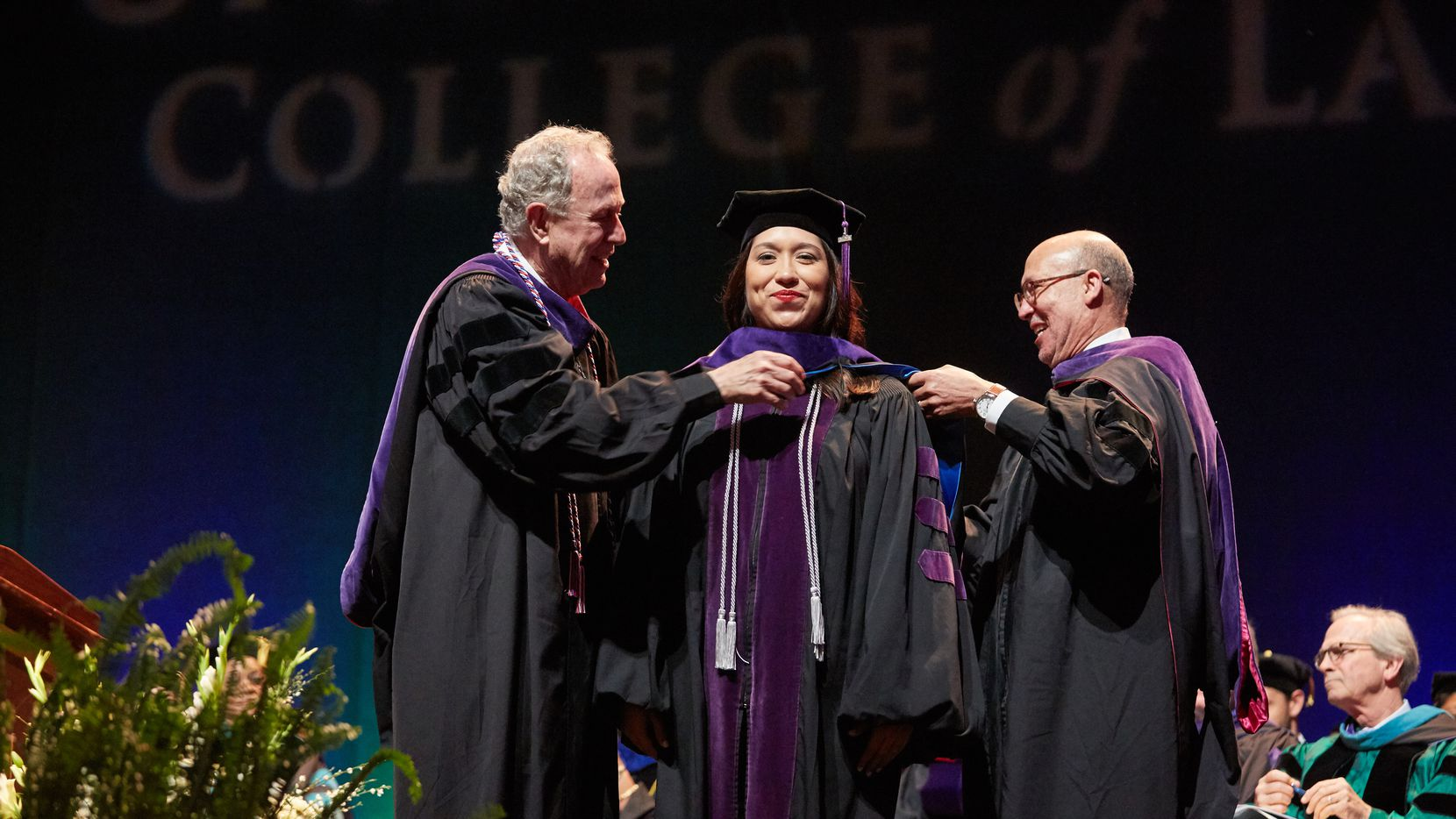 Dean Royal Furgeson of the University of North Texas Dallas College of Law, left, places an academic hood on a member of the 2017 graduating class at the Majestic Theatre in Dallas on May 20, 2017. Thirty-five members of the class, the new law school's first, were recently told they had passed bar exams taken in July.