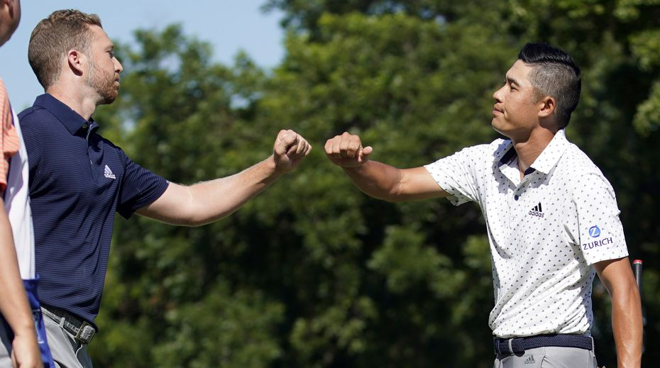 PGA Tour golfer Collin Morikawa gives winner Daniel Berger a fist bump after he missed a putt during a playoff in the final round of the Charles Schwab Challenge at the Colonial Country Club in Fort Worth, Sunday, June 14, 2020.  Berger defeated Morikawa after a one hole playoff. The Challenge is the first tour event since the COVID-19 pandemic began. (Tom Fox/The Dallas Morning News)