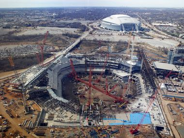 Construction continues on Globe Life Field, the future home of the Texas Rangers in Arlington on Tuesday, December 11, 2018. AT&T Stadium can be seen in the background. (Vernon Bryant/The Dallas Morning News)