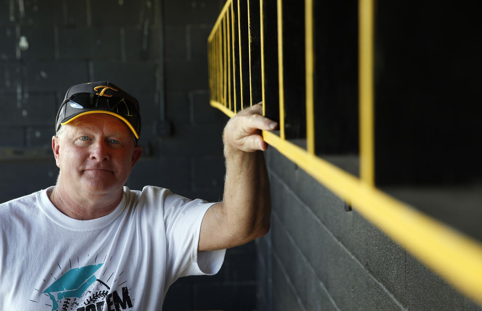 Forney High School's head softball coach Pat Eitel poses for a portrait in the dugout of Forney High School's softball field in Forney, on Wednesday, May 27, 2020.