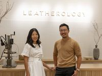 Rae Liu (left) stands with her brother David Liu at their Leatherology store at NorthPark Center in Dallas.