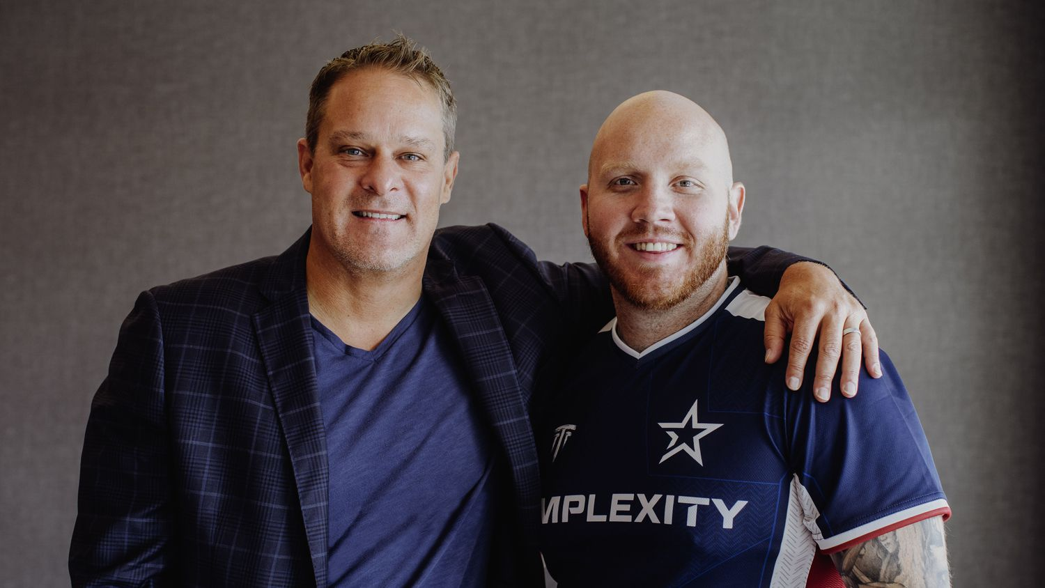 """Complexity Gaming owner Jason Lake (left) stands with Timothy """"TimTheTatMan"""" John Betar (right). TimTheTatMan, who has over 2.6 million Twitter followers as a gaming content creator, announced he was joining Complexity Monday afternoon."""