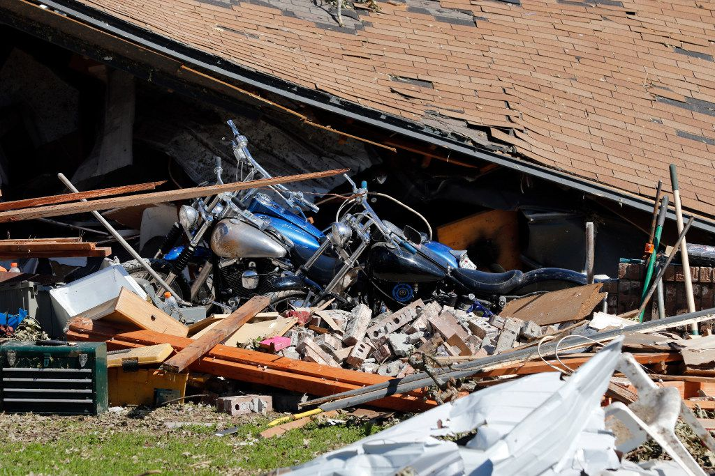 Bo and Britney Carroll's garage collapsed after tornadoes passed through Emory, Texas on Saturday night, April 29, 2017. They hope some of their treasured family Christmas ornaments survived. Six tornadoes swept through Van Zandt, Henderson and Rains counties killing four people and injuring many more. (David Woo/The Dallas Morning News)