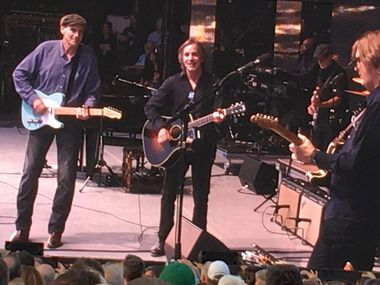 """James Taylor and Jackson Browne sing a duet of """"Take It Easy"""" during a sold-out show at Wrigley Field in Chicago on Thursday night, June 30, 2016."""