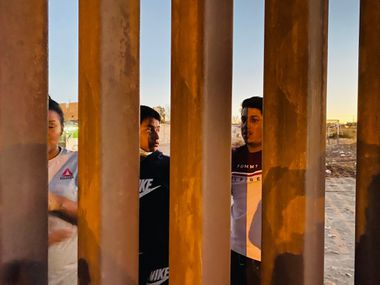 """Neighbors in Anapra, Mexico, across from Sunland Park, New Mexico, describe how migrants climb over the new border wall """"in a minute, or less."""" Sometimes, they injure themselves, and such incidents are routine."""