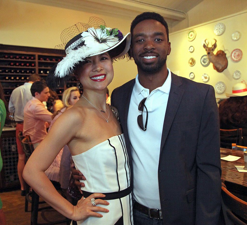 Dallas residents Hanjia Wang (left) and Aaron Sanders at Sissy's Southern Kitchen and Bar in Dallas during the third annual Jockeys and Juleps party recognizing the Kentucky Derby on Saturday, May 3, 2014. (Stewart F. House/Special Contributor)