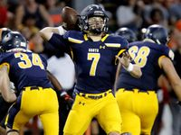 Highland Park quarterback Brennan Storer (7) throws a pass during the first half against Rockwall on Friday, September 17, 2021.