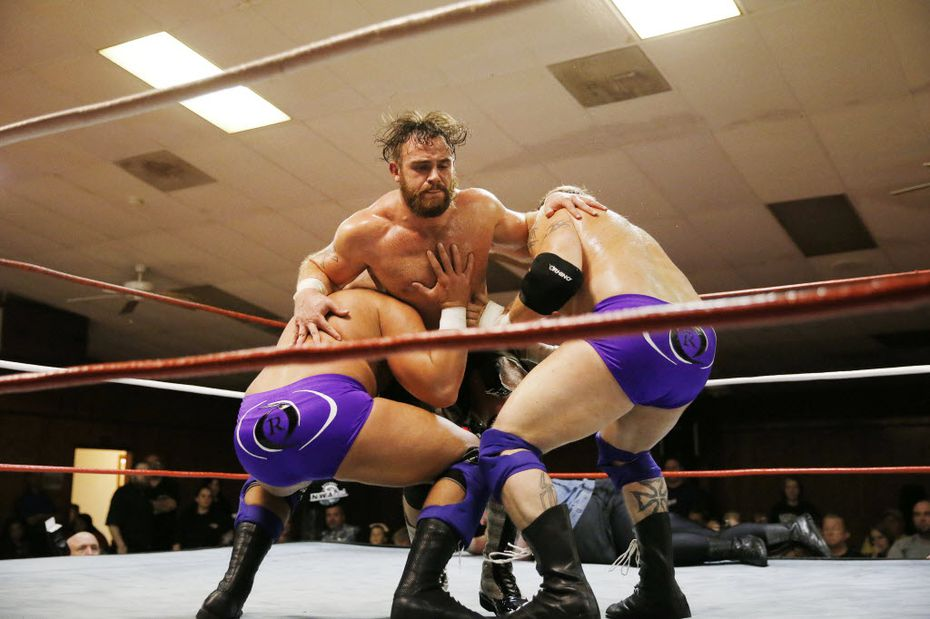 Moonshine Mantell (top center) takes on tag team opponents Seth Allen (left) and Dane Griffin during a match in Sherman.