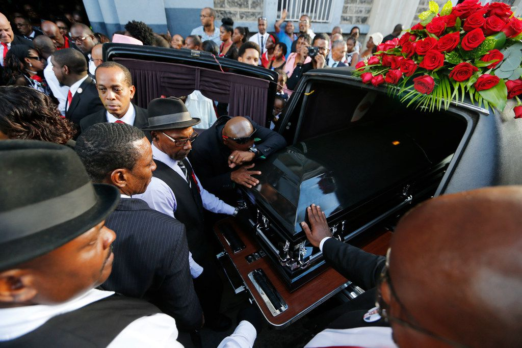 Pallbearers and others mourn Botham Shem Jean during the funeral at Minor Basilica of the Immaculate Conception in Castries, St. Lucia on Monday, September 24, 2018. Jean was shot and killed in his apartment by off duty Dallas police officer Amber Guyger. (Vernon Bryant/The Dallas Morning News)